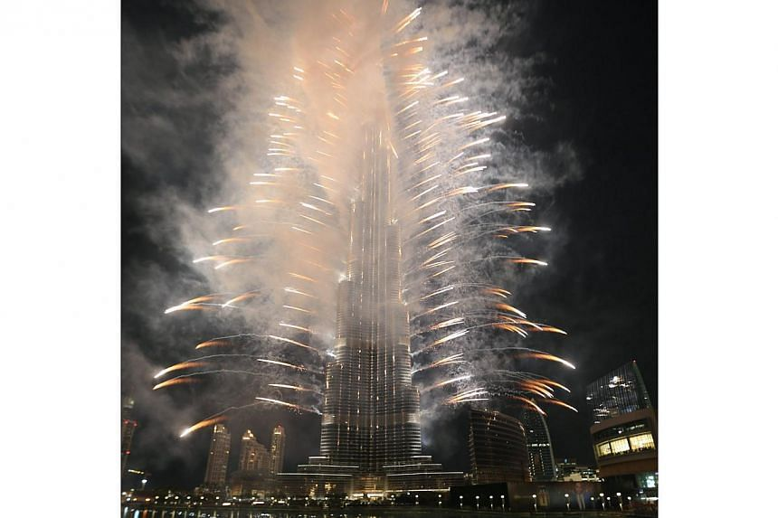 Fireworks are seen as people celebrate after Dubai won the right to host the 2020 World Expo, in front of the Burj Khalifa in Dubai on Nov 27, 2013. Dubai beat off opposition from Brazil, Russia and Turkey on Wednesday to win the right to host the 20