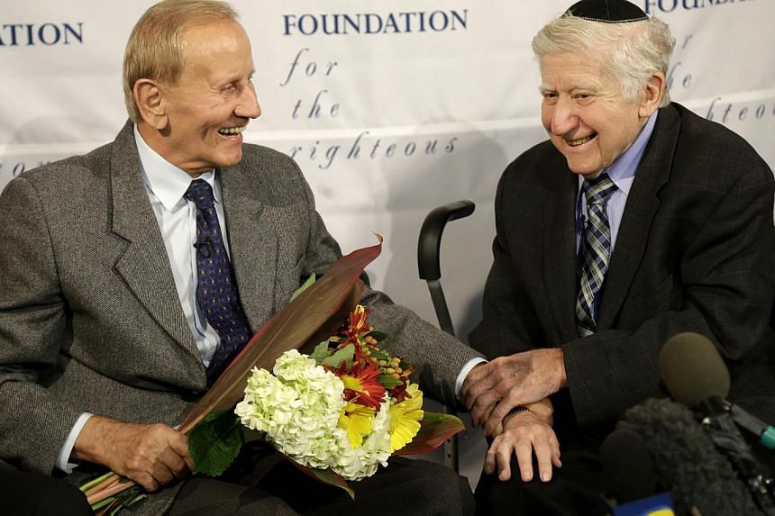 Mr Leon Gersten (right) and Mr Czeslaw Polziec, of Poland, talk with the media after reuniting after 69 years in New York, onNov 27, 2013. A Jewish boy who hid from the Nazis in a haystack was reunited in New York after 70 years on Wednesday wi