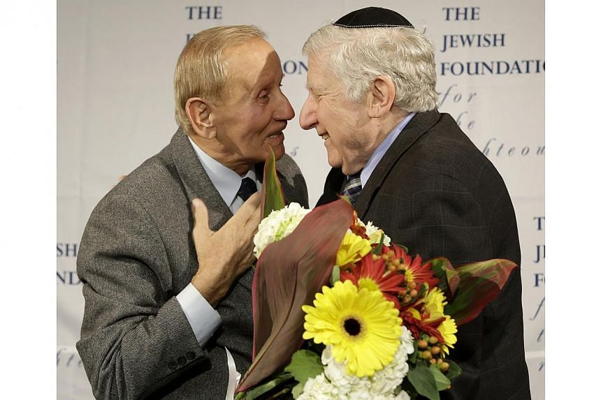 Mr Leon Gersten (right) greets Mr Czeslaw Polziec, of Poland, after they had not seeing each other for 69 years in New York, onNov 27, 2013. A Jewish boy who hid from the Nazis in a haystack was reunited in New York after 70 years on Wednesday