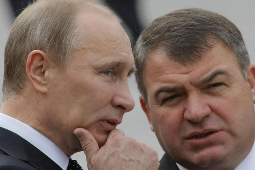 Russian Prime Minister Vladimir Putin (left) and then Russian Defence Minister Anatoly Serdyukov speak during a wreath laying ceremony at the Tomb of Unknown Soldier on the eve of the Victory Day on Sunday, May 8, 2011.Russian investigators on