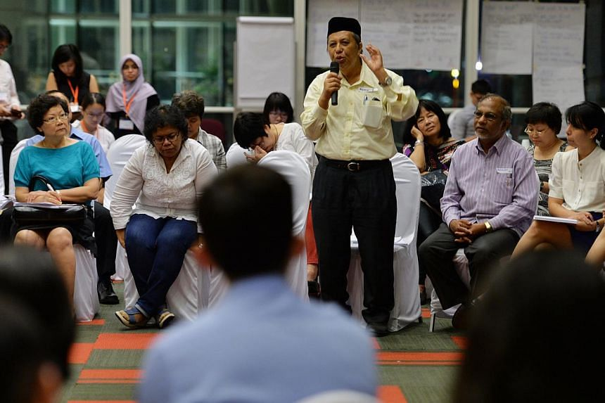 Singaporeans at government feedback unit Reach's first pre-Budget dialogue for the year sharing their views at the National Library Building on Thursday, Nov 28, 2013. Medifund will continue to be expanded as one of the ways to he