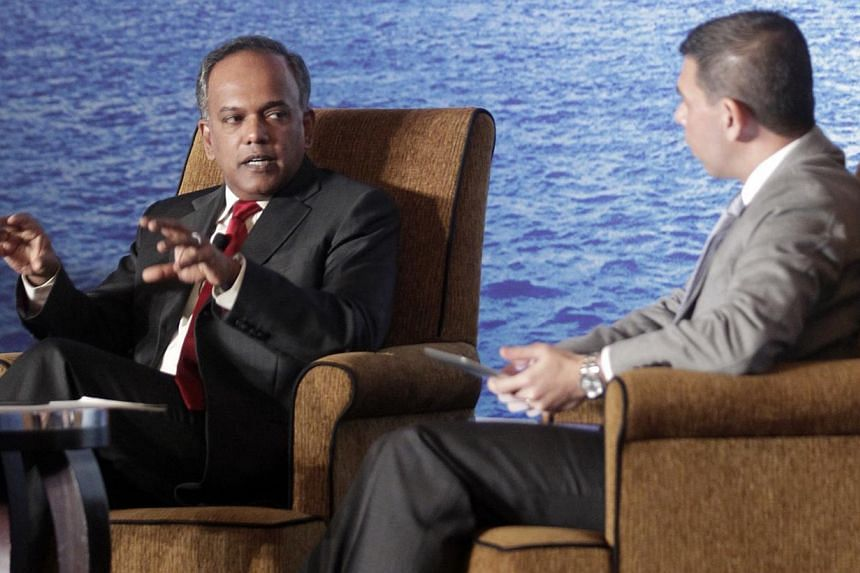 Law and Foreign Minister K. Shanmugam (left) with Straits Times Editor Warren Fernandez at the ST Global Forum on Nov 29, 2013. The minister said that the Government is not out to curtail freedom of expression but it believes people should be held ac