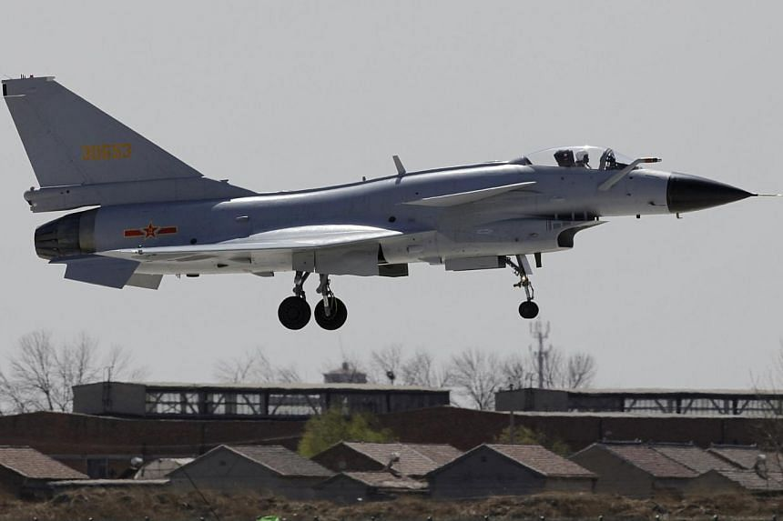 A Jian-10 fighter jet of China Air Force flies at Yangcun Air Force base on the outskirts of Tianjin municipality in this April 13, 2010 file photo during a media trip to the 24th Air Force Division of the People's Liberation Army. China sent fi
