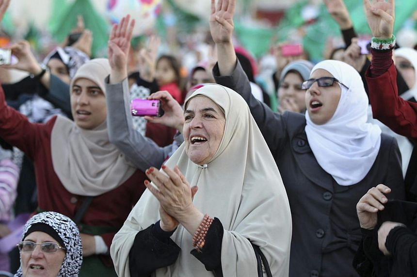 Supporters of the Islamic Front Action party shouts slogans against Israel during a rally in Amman, on Oct 25, 2013.Restrictions on protests and hefty jail terms for girl demonstrators are reviving Egypt's autocratic past, say activists and ers