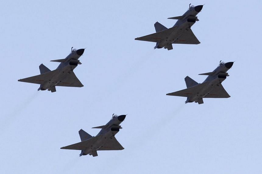 "Jian-10 fighter jets of China Air Force fly at Yangcun Air Force base on the outskirts of Tianjin municipality, April 13, 2010. Chinese state-run media on Friday identified Japan as Beijing's ""prime target"" in its newly declared air defence zone, cal"