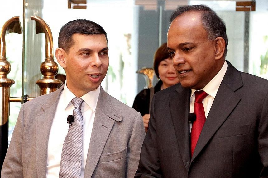 Straits Times Editor Warren Fernandez (left) with Law and Foreign Minister K. Shanmugamat the ST Global Forum on Nov 29, 2013. The minister said that the Government is not out to curtail freedom of expression but it believes people should be he