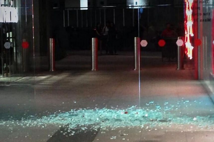 A glass door at Jurong East's Jem mall shattered on Friday night - the latest in a string of incidents to befall the shopping mall. -- PHOTO: TWITTER OF THOMAS SIM