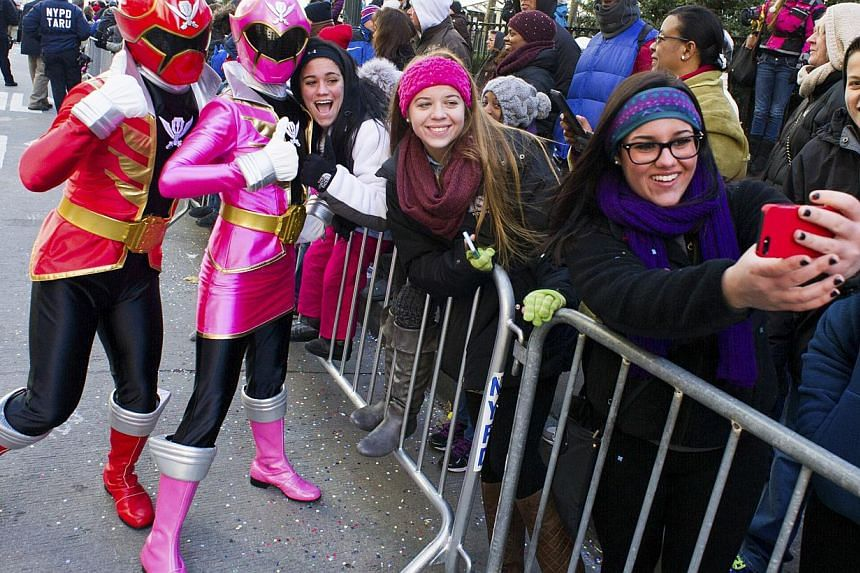 Saban's Power Rangers Super Megaforce greet fans as they walk in the Macy's Thanksgiving Day Parade in New York City on Nov 28, 2013. -- PHOTO: AP