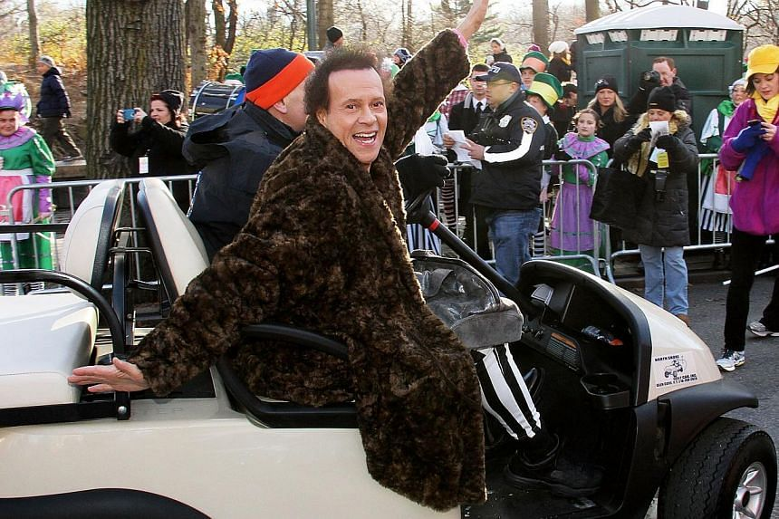 Richard Simmons attends the 87th Annual Macy's Thanksgiving Day Parade in New York City on Nov 28, 2013. -- PHOTO: AFP