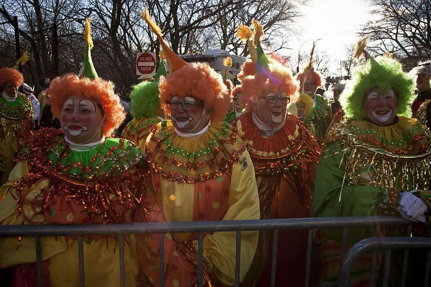 People dressed as clowns attend the Macy's Thanksgiving Day Parade in New York City on Nov 28, 2013. -- PHOTO: AFP