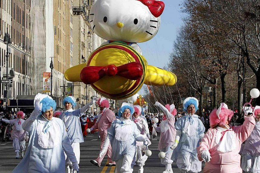 The Hello Kitty balloon floats down Central Park West during the 87th Macy's Thanksgiving Day Parade in New York, on Nov 28, 2013. -- PHOTO: REUTERS