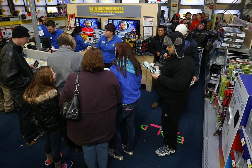Thanksgiving Day holiday shoppers wait in line to buy a television at the Best Buy retail store in North Aurora, Illinois, on Nov 28, 2013. Instead of waiting for Black Friday, which is typically the year's biggest shopping day, more than a dozen maj