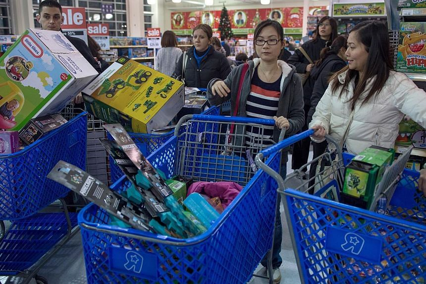 Shoppers looking for a bargains shop during the Thanksgiving holiday on Nov 28, 2013, at the Toys 'R' Us store in Fairfax, Virginia. Instead of waiting for Black Friday, which is typically the year's biggest shopping day, more than a dozen major reta