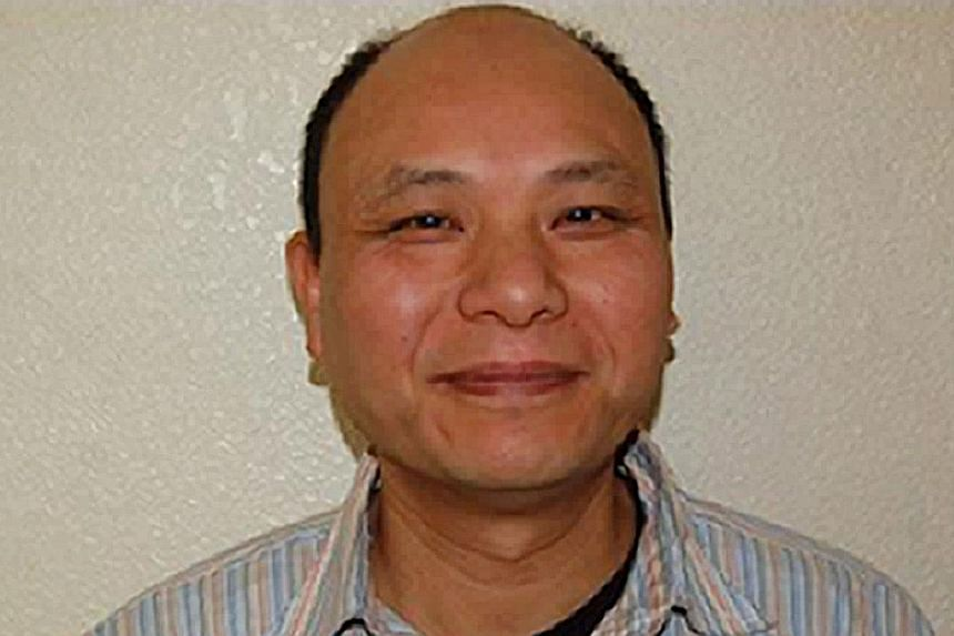 A handout picture obtained in London on Nov 27, 2013, from Britain's Northamptonshire Police, shows Chinese citizen Du Anxiang.A businessman who butchered a Chinese family of four in Britain was told he would likely die in jail as he was senten