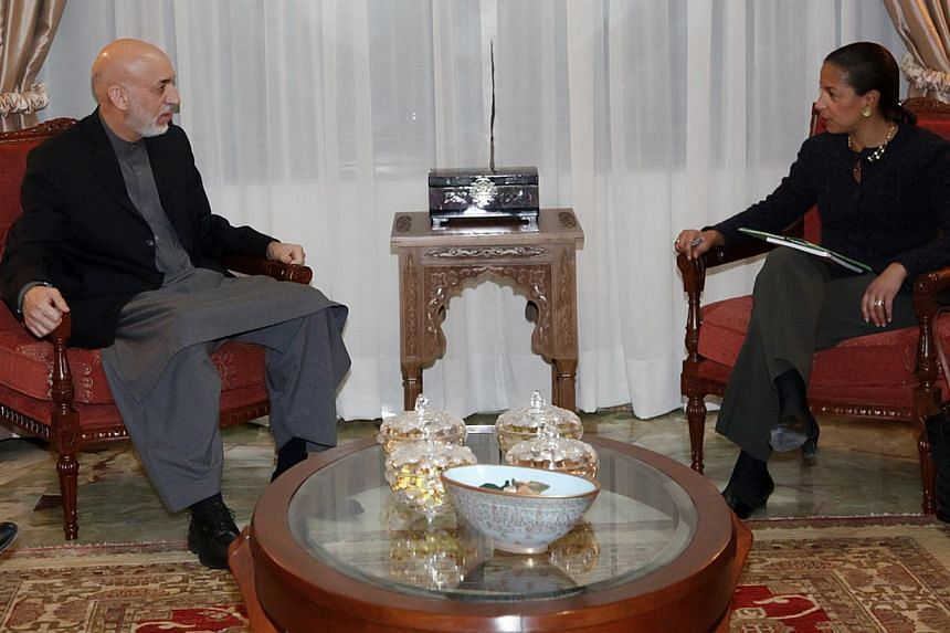 Afghan President Hamid Karzai (left) meets with US National Security Advisor Susan Rice in Kabul in this handout provided by the Afghan presidential palace taken on Nov 25, 2013.MrKarzai said US forces had bombed a home in southern Afghan