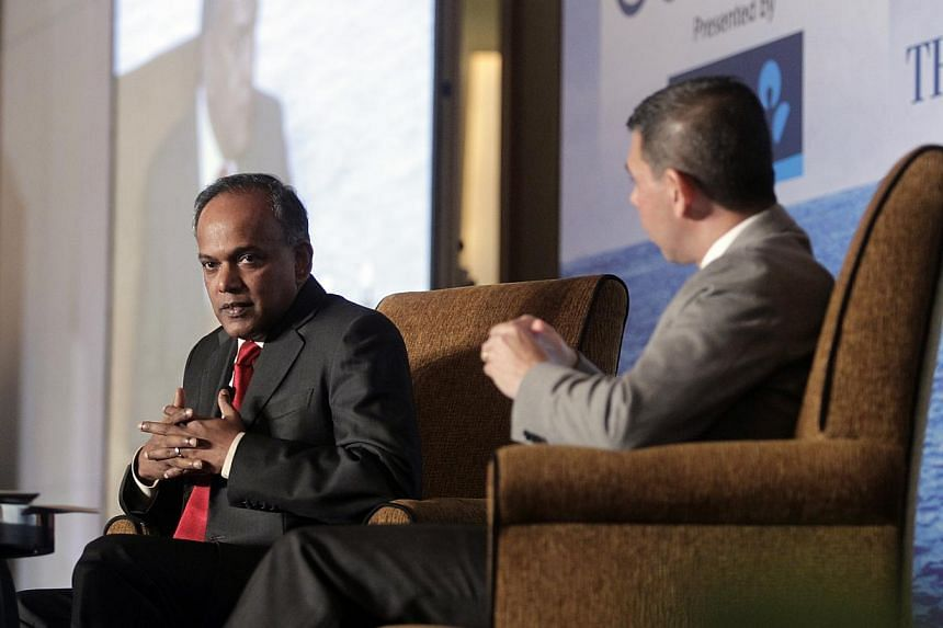 Law and Foreign Minister K. Shanmugam (left) with Straits Times Editor Warren Fernandez at the ST Global Forum on Nov 29, 2013.Mr Shanmugam gave his first comments on allegations that Singapore had spied on its neighbours at the forum. -- ST PH