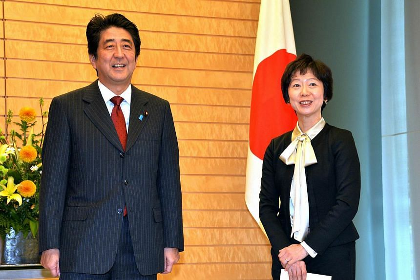 Ms Makiko Yamada with Japanese Prime Minister Shinzo Abe at her appointment ceremony as an aide to the Prime Minister at the Prime Minister's official residence in Tokyo on Nov 29, 2013. Ms Yamada was named the country's first ever female aide to the