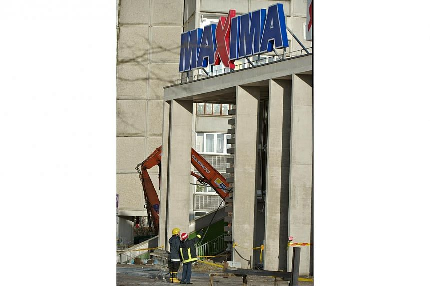 Investigators inspect the Maxima supermarket site in Riga on Nov 25, 2013, four days after the roof of the building caved in on shoppers. Lithuanian retail chain Maxima Group fired the chairman of its Latvian operations on Thursday after he stir