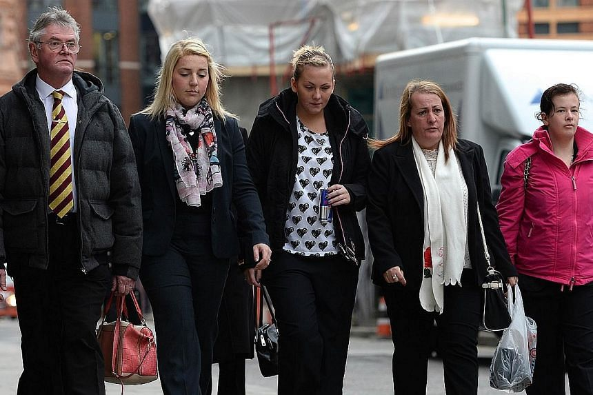 Family members and loved ones of murdered soldier Lee Rigby, Ian Rigby, his stepfather (left), his fiance Aimee West (second from left) his sister Sara McClure (centre) and his mother Lyn Rigby (second from right) arrive at the Old Bailey in London,