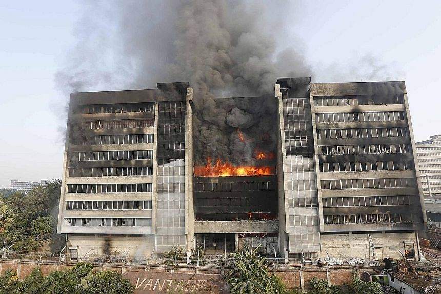 Smoke rising from a huge fire that destroyed this Bangladesh garment factory near Dhaka supplying Western brands, on Friday, Nov 29, 2013. The blaze was believed to be started by workers angered by rumours of a colleague's death under police fire.&nb