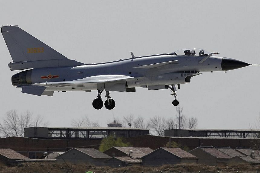 "A Jian-10 fighter jet of the China Air Force flying at the Yangcun Air Force base on the outskirts of Tianjin municipality in  2010. China's state media called, on Friday, Nov 29, 2013, for ""timely countermeasures without hesitation"" if Jap"