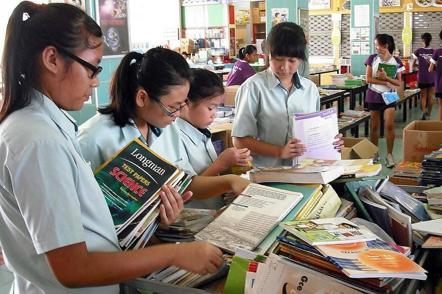 With just over a week left to its Dec 8 deadline, NTUC FairPrice is still short of 285,000 textbooks for its longstanding Share-A-Textbook Project, which helps students from low-income families. -- FILE PHOTO: NTUC FAIRPRICE