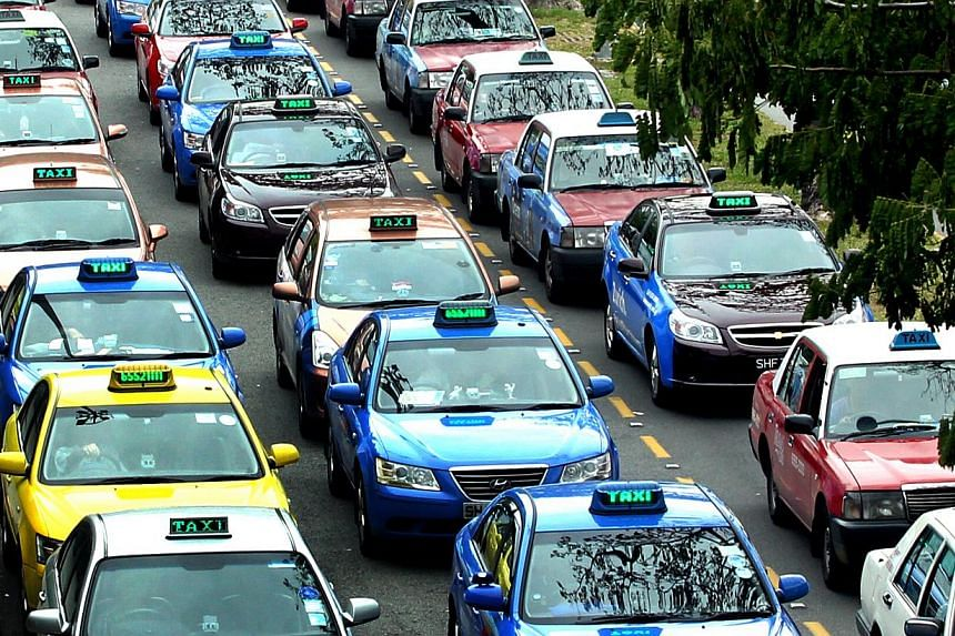 The standards set for taxi companies to ensure enough cabs are on the road when demand is at its peak is a good move, but it is not enough to solve the problem, said observers and taxi drivers. -- ST FILE PHOTO: CHEW SENG KIM