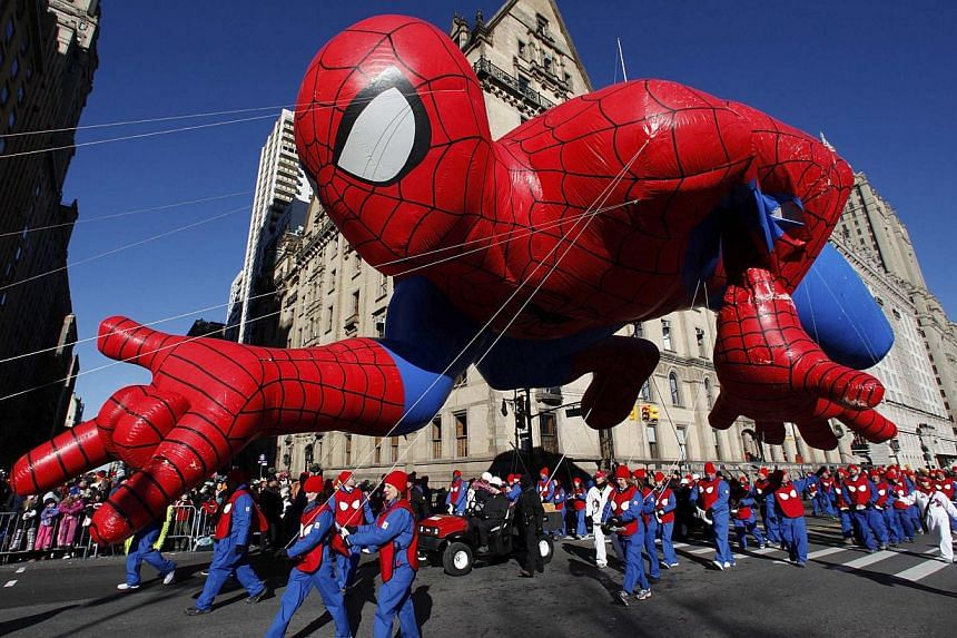 A giant Spiderman balloon floating down Central Park West during the 87th Macy's Thanksgiving Day Parade in New York on November 28, 2013. -- PHOTO: REUTERS
