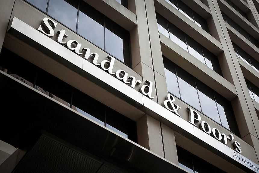Standard & Poor's cut theNetherlands' credit rating from triple A to AA+ on Nov 29, 2013, while upgrading its outlook on Spain from negative to stable. -- FILE PHOTO: BLOOMBERG