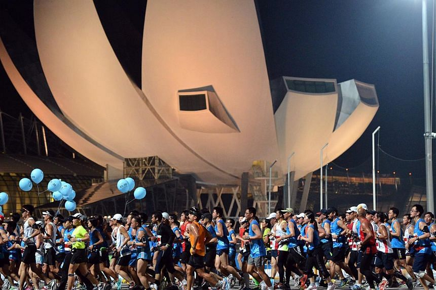 Participants of the Standard Chartered Marathon Singapore 2012 making their way past the ArtScience Museum on the early morning of Dec 2, 2012. Top runners in this year's edition say they are unlikely to clock anywhere close to their best times becau