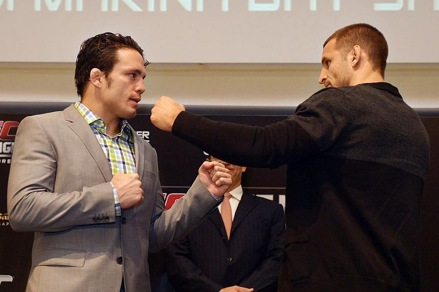 AMERICAN fan favourite Jake Ellenberger (left) has dropped out of his main event bout with Strikeforce welterweight champion Tarec Saffiedine (right) at the Ultimate Fighting Championship's inaugural Singapore show after suffering a torn hamstri