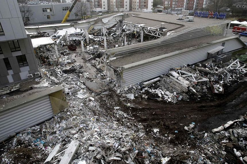 A general view of a collapsed supermarket in Riga on Nov 25, 2013. The builders of a supermarket that collapsed in Latvia last week, killing 54 and injuring dozens, released a preliminary report on Friday saying the cause was likely a design error.&n