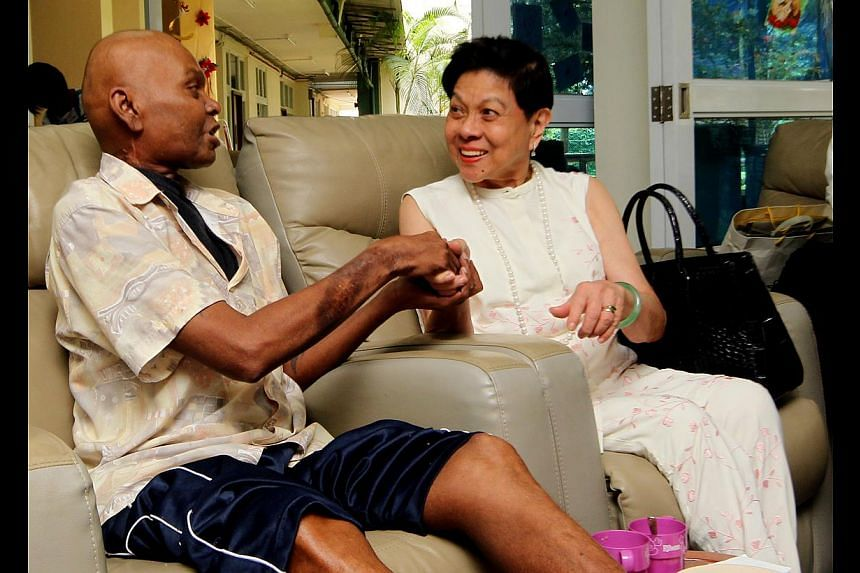 Madam Khoo Bee See, daughter of the late Khoo Teck Puat, with Assisi Hospice patient Manogaran Sannasi. Madam Khoo has pledged $1 million to the hospice.