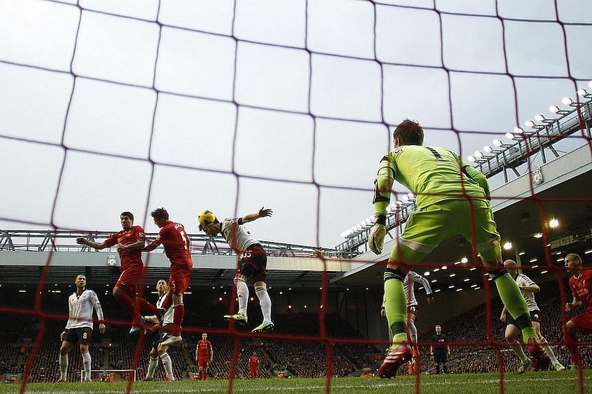 Luis Suarez scores a goal for Liverpool against Fulham at Anfield on Nov 9, 2013. Find out how you can play on the Anfield pitch and score a goal at the Kop end below. -- FILE PHOTO: REUTERS