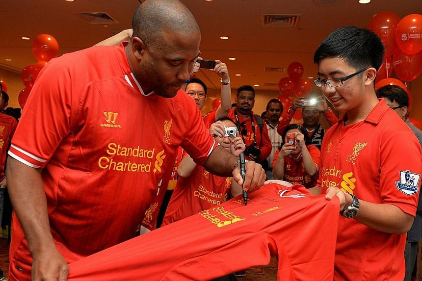 He beat almost 300 other entries to win a Liverpool jersey signed by a former player, but Benjamin Lew (right) got so much more when he arrived at the Swissotel The Stamford on Saturday afternoon.The 15-year-old student was also surprised when
