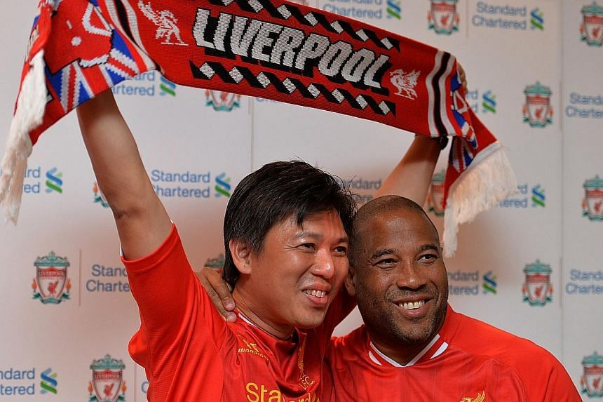 Liverpool legend John Barnes poses with Eric Foo after a meet-and-greet session.-- ST PHOTO:CAROLINE CHIA
