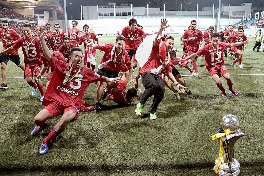 The LionsXII charge towards the Malaysian Super League trophy on July 2, 2013. The next LionsXII coach has been chosen, but fans will have to wait a few more days for his public unveiling. -- ST FILE PHOTO: LIM SIN THAI
