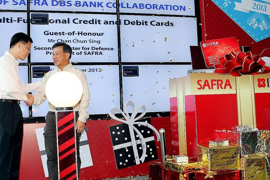 Second Minister for Defence Chan Chun Sing (left), who is also Safra president, with Mr Sim S. Lim, country head of DBS Singapore, at the launch ceremony of the new Safra DBS credit and debit cards. Safra and DBS Bank have collaborated to come up wit