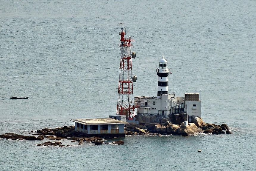 Singapore and Malaysia will set up a sub-committee to draw up maritime boundaries around the disputed areas of Pedra Branca (pictured), Middle Rocks and South Ledge.-- ST FILE PHOTO:ALPHONSUS CHERN