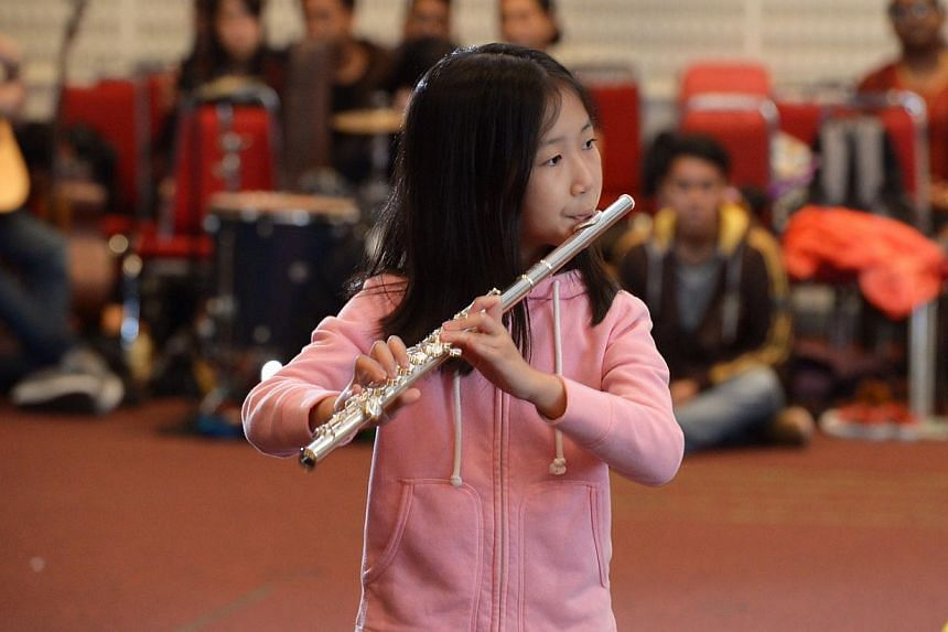 Young Gymnasts From CHIJ (Kellock) School aim to enchant the audience during the opening act as the orchestra plays movements from Camille Saint-Saens' Carnival Of The Animals, while award-winning flautist Ong Yi Ting (above) will be showing off the