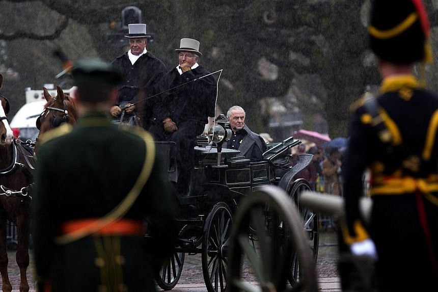 Dutch actor Huub Stapel (centre) as Prince Willem Frederik, later King William I, performs during a ceremony on Square 1813 (Dutch: Plein 1813), for the celebrations marking the 200-year anniversary of the Kingdom of the Netherlands, in The Hague, Th