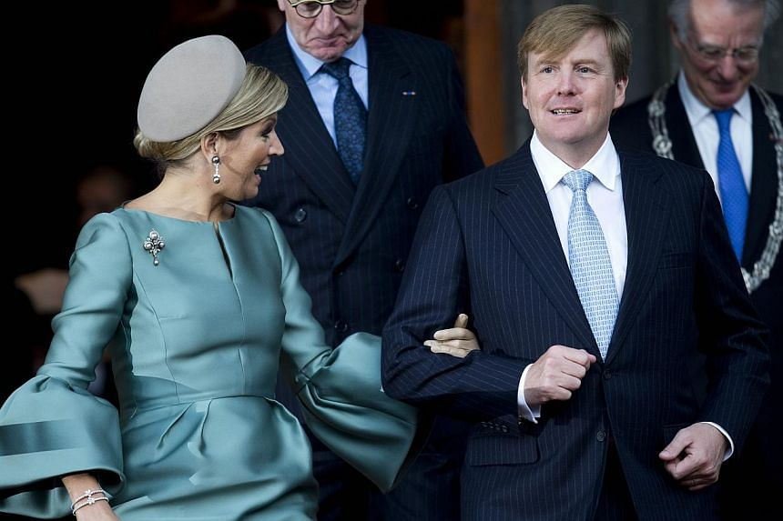 Dutch King Willem-Alexander (right) and Queen Maxima (left) leave the Ridderzaal where they celebrated the 200-year anniversary of the Kingdom of the Netherlands, in The Hague, The Netherlands on Nov 30, 2013. -- PHOTO: AFP