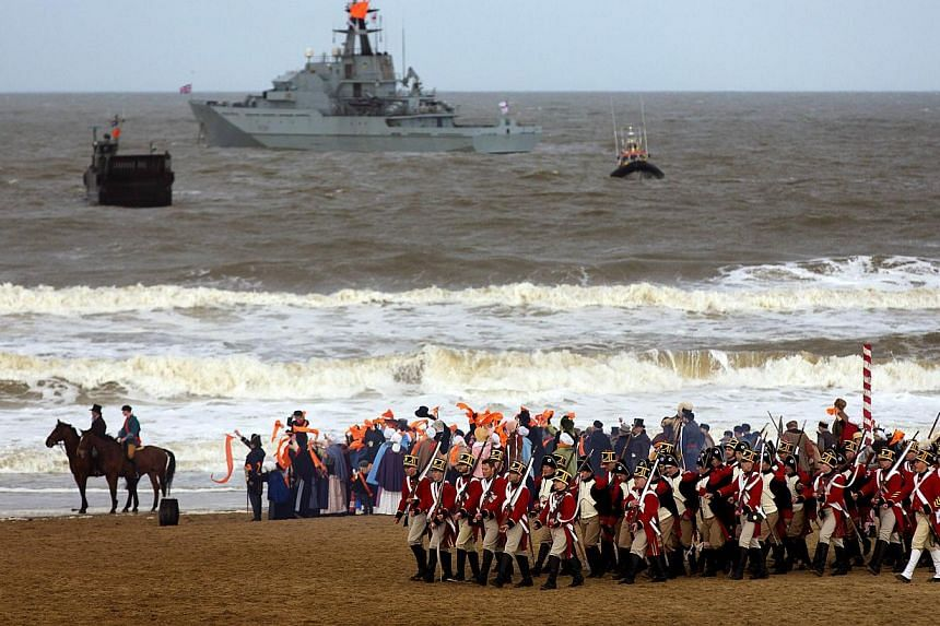 The reenactment of the historic landing of Prince Willem Frederik, later King William I, takes place on the beach of Scheveningen, for the celebrations marking the 200-year anniversary of the Kingdom of the Netherlands, in Scheveningen, The Netherlan