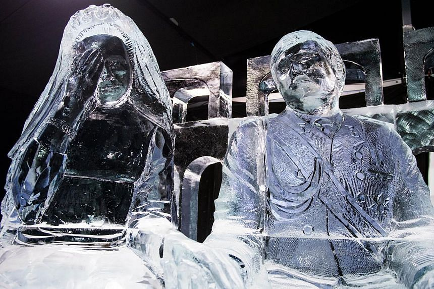 An ice sculpture of King Willem-Alexander and Queen Maxima is displayed on the theme 200 Years Kingdom Of The Netherlands in Zwolle, the Netherlands on Nov 29, 2013. -- PHOTO: AFP