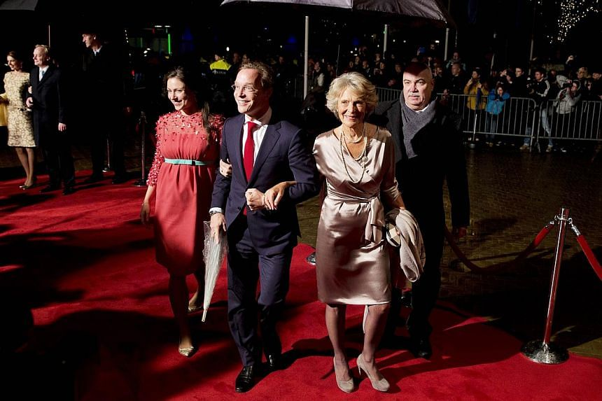 Dutch Princess Irene (right) arrives with her son Jaime de Bourbon de Parme (centre) and his wife Viktória (left) at the Circus Theatre for the celebrations marking the 200-year anniversary of the Kingdom of the Netherlands, in Scheveningen on Nov 3