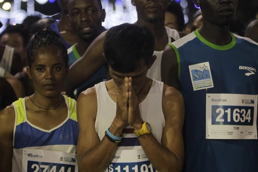 Prasoet Phaisan of Thailand prays at the starting point for the 42.195km in the Standard Chartered Marathon 2013 on Dec 1, 2013. -- ST PHOTO: KEVIN LIM
