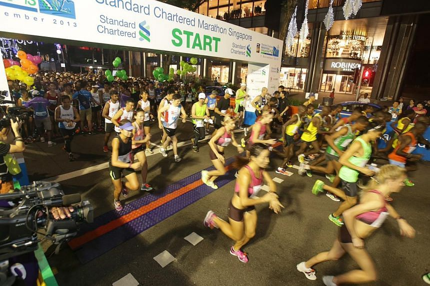 Flag off for the elite runners, which includes Singaporean Mok Ying Ren, in the 42.195km of the Standard Chartered Marathon 2013 on Dec 1, 2013. -- ST PHOTO: KEVIN LIM