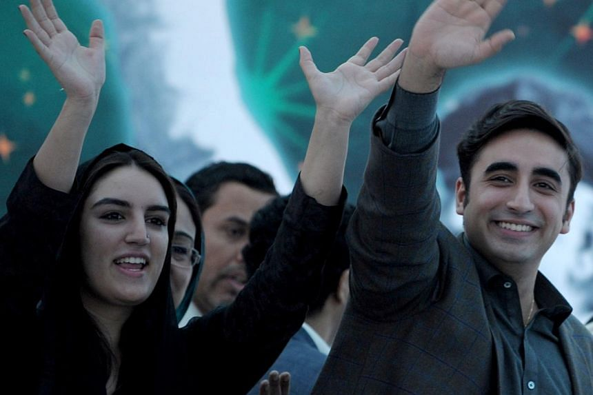 Chairman of Pakistan Peoples Party, Bilawal Bhutto Zardari (right) and his sister Bakhtawar wave to supporters at a rally in Karachi on Nov 30, 2013. Mr Bilawal Bhutto Zardari, the son of Pakistan's slain premier Benazir Bhutto, vowed on Saturday to