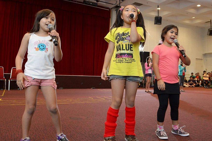 (From left)Akira McLatchie, 7, Noa Suzuki, 10 and Anne-Sophie Cazaubon, 6 are among the youngest performers in the concert. They are singing a medley of three songs - Over the Rainbow, Lollipop and It's A Small World, which will get the audienc