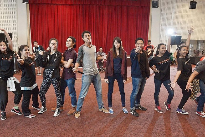 The acoustic group from Republic Polytechnic and dancers from Saltare Beats collaborated in a dynamic performance entitled Buttons. Saltare Beats members are beneficiaries of The Business Times budding artists fund. -- ST PHOTO: DESMOND WEE